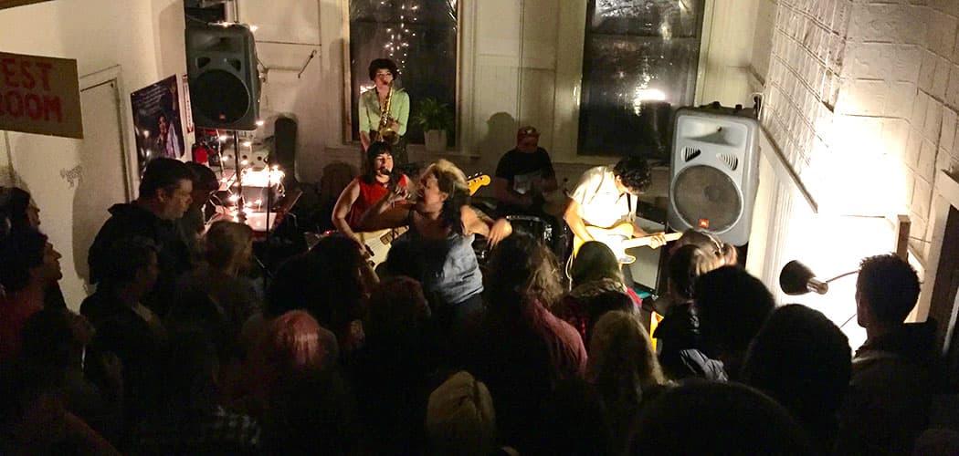 Downtown Boys perform at the Feb. 5  Break the Chains. (Amelia Mason for WBUR)