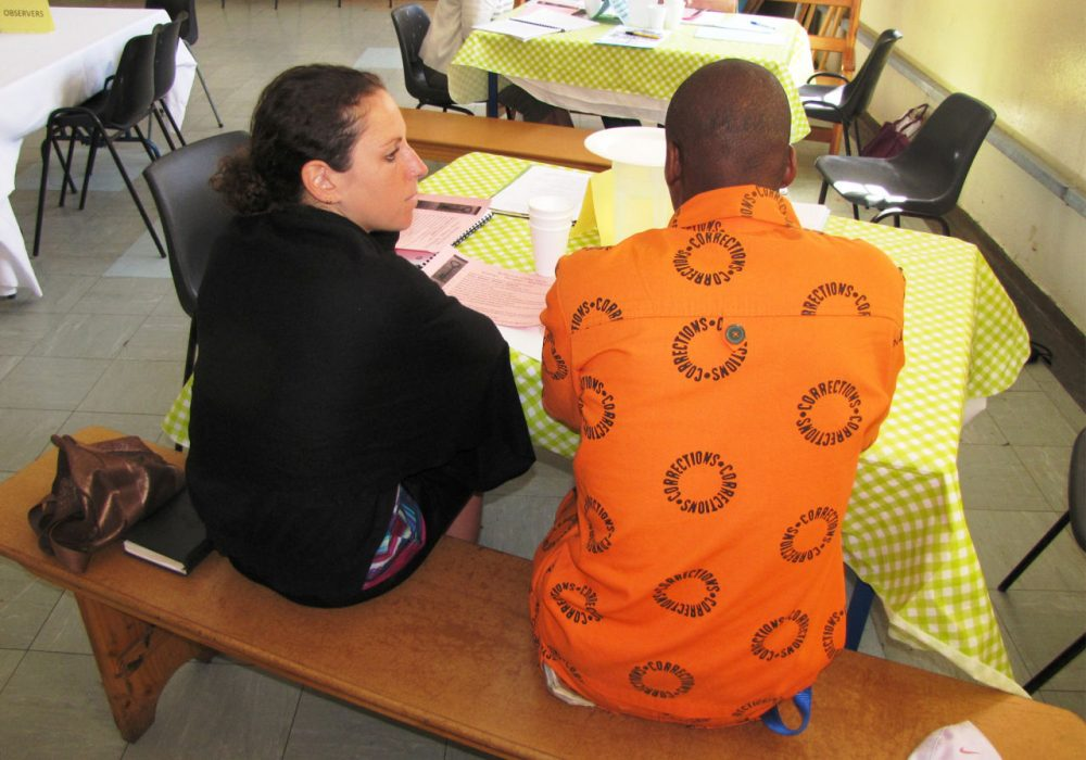 In Pollsmoor Prison in South Africa, author Baz Dreisinger talks with a prisoner at a restorative justice workshop. (Courtesy of Baz Dreisinger)