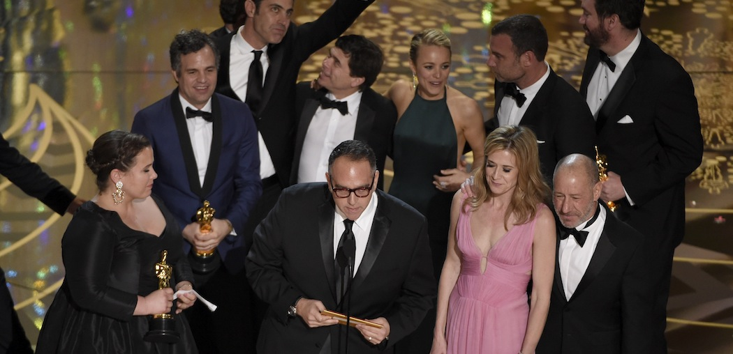 The cast and crew, along with Boston Globe reporter Michael Rezendes (next to Rachel McAdams)  celebrate their Oscar win last night. (Chris Pizzello/Invision/AP)
