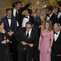 Nicole Rocklin, from left, Michael Sugar, Blye Pagon Faust, Steve Golin, and cast and crew of ìSpotlightî accept the award for best picture for ìSpotlightî at the Oscars on Sunday, Feb. 28, 2016, at the Dolby Theatre in Los Angeles. (Chris Pizzello/Invision/AP)
