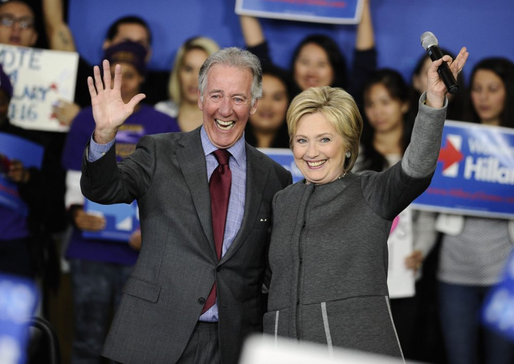 Democratic presidential candidate Hillary Clinton and Rep. Richard Neal, D-Mass. wave during a campaign event, Monday in Springfield, Mass. (AP Photo/Jessica Hill)