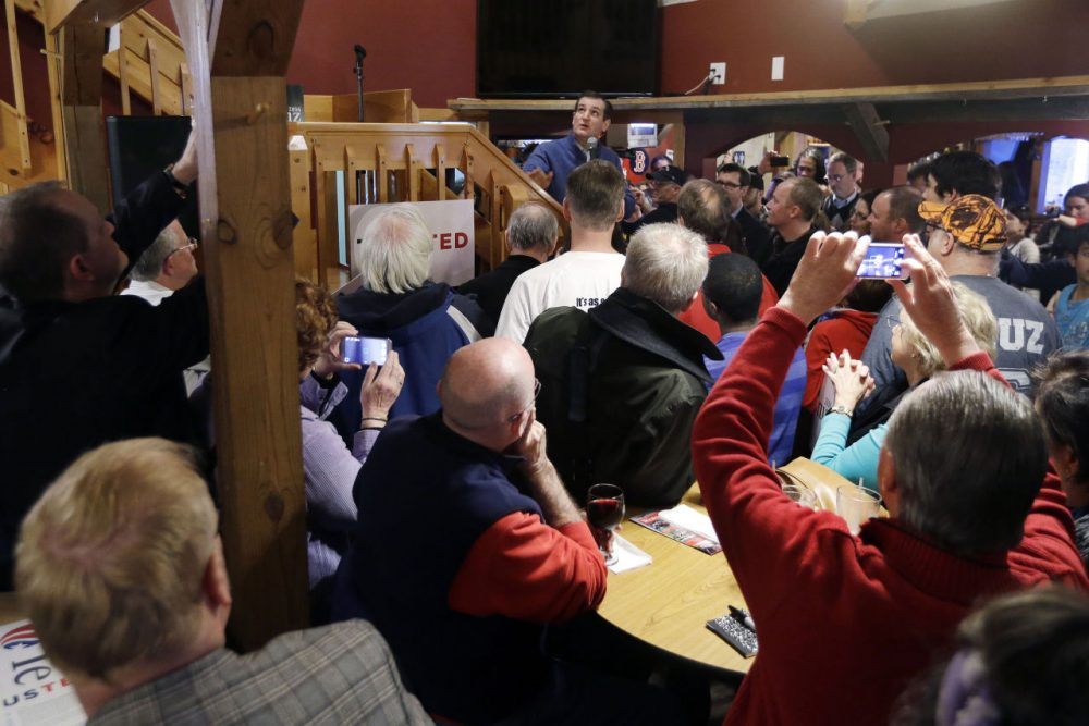 Republican presidential candidate, Sen. Ted Cruz, R-Texas, (middle, back) speaks during a campaign event at Generals Sports Bar and Grill, Thursday, Feb. 4, 2016, in Weare, N.H. (AP Photo/Elise Amendola)