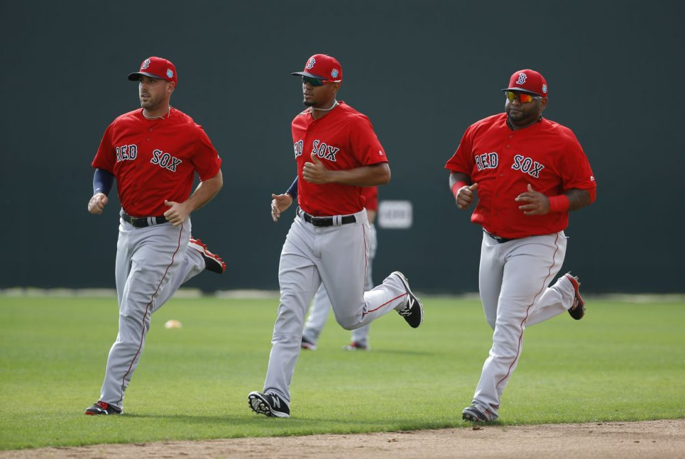 Boston Red Sox infielders, from left, Travis Shaw, Xander Bogaerts and Pablo Sandoval run during a spring training baseball workout in Fort Myers, Fla., on Wednesday. (Patrick Semansky/AP)