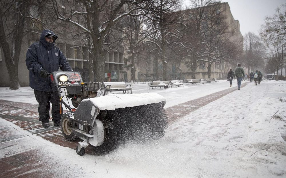 John Moreira clears snow from Monday's storm off sidewalks on Commonwealth Ave. (Robin Lubbock/WBUR)