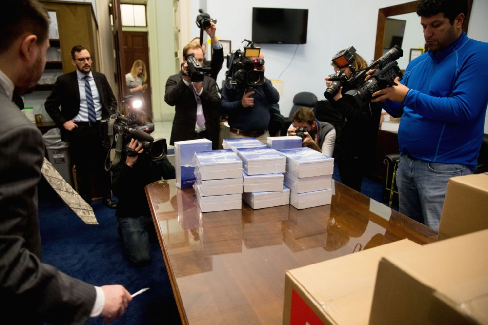 Members of the media surround copies of the President Obama's fiscal 2017 federal budget as they arrive on Capitol Hill last Tuesday. (AP Photo/Andrew Harnik)