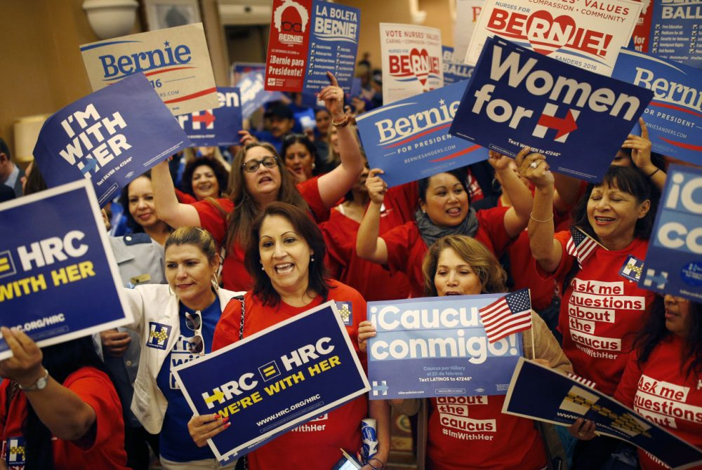 Supporters of Hillary Clinton and Bernie Sanders cheer on their candidates during the Nevada Democratic caucus on Saturday. (AP Photo/John Locher)