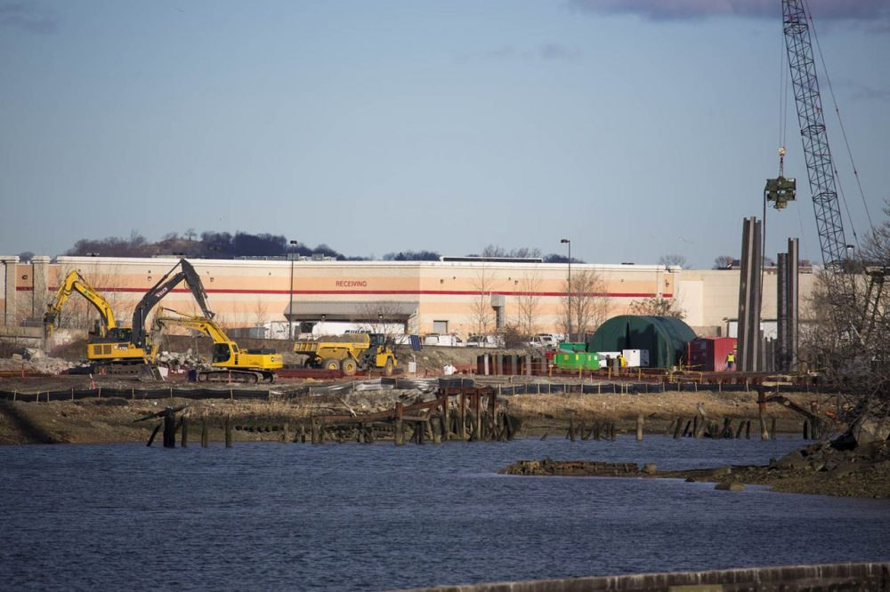 Contractors working on the area where the proposed Wynn Casino in Everett will exist. (Jesse Costa/WBUR)