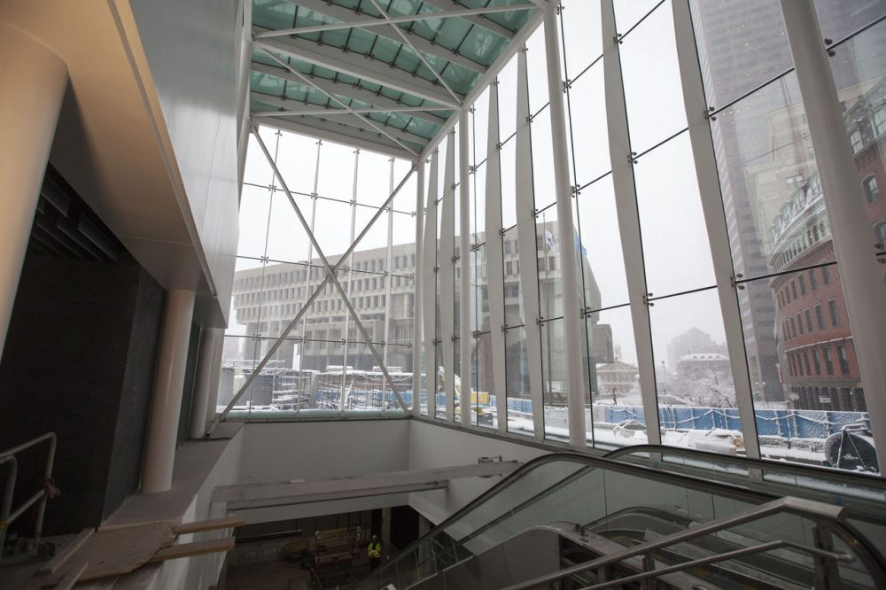 The MBTA's Government Center station reopened Monday after two years of renovations.  The new station has a 40-foot-high glass entryway (pictured here last month), elevators and remodeled platforms. The project cost $82 million and makes the station accessible for the first time. (Joe Difazio for WBUR)
