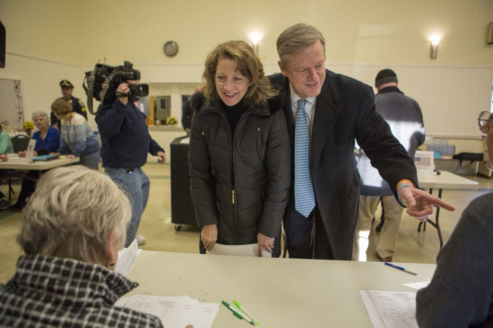 Massachusetts Gov. Charlie Baker and his wife Lauren check in to vote in Swampscott on Super Tuesday. (Jesse Costa/WBUR)