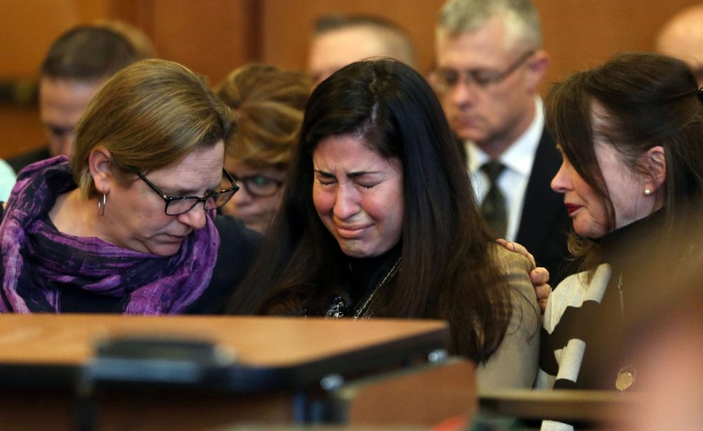 Diane Chism, mother of Philip Chism, sobs while being consoled during her son's sentencing in the murder and rape of Colleen Ritzer. (David Le/The Salem News/AP)
