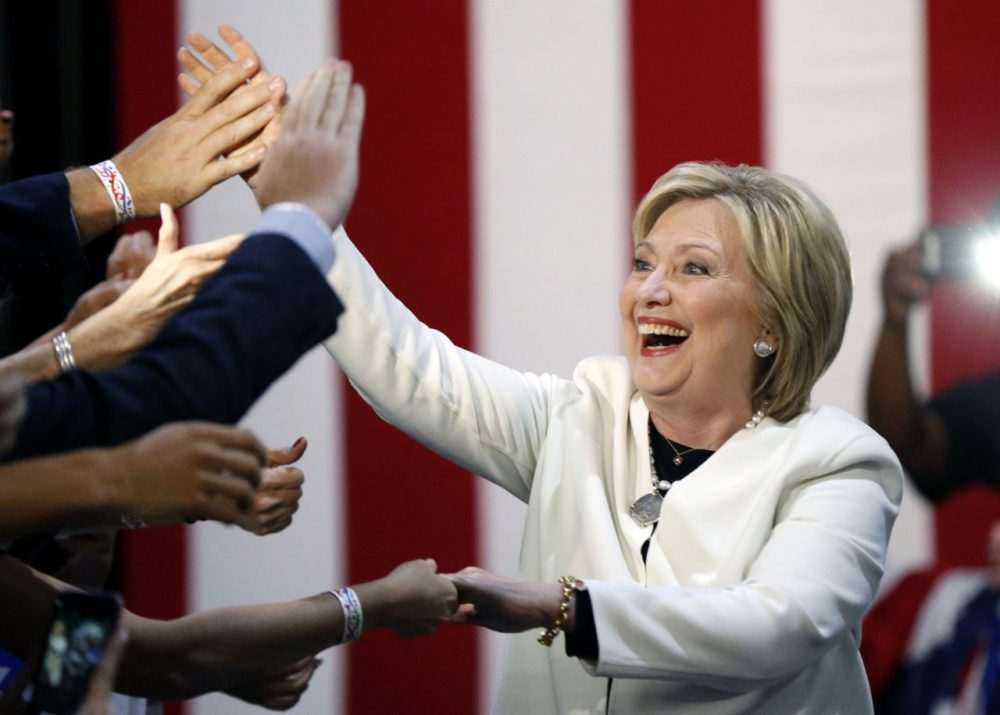 Clinton reacts to supporters as she arrives to address supporters at her Super Tuesday election night rally in Miami. The Democrat won in several states, including in a close race in Massachusetts. (Gerald Herbert/AP)