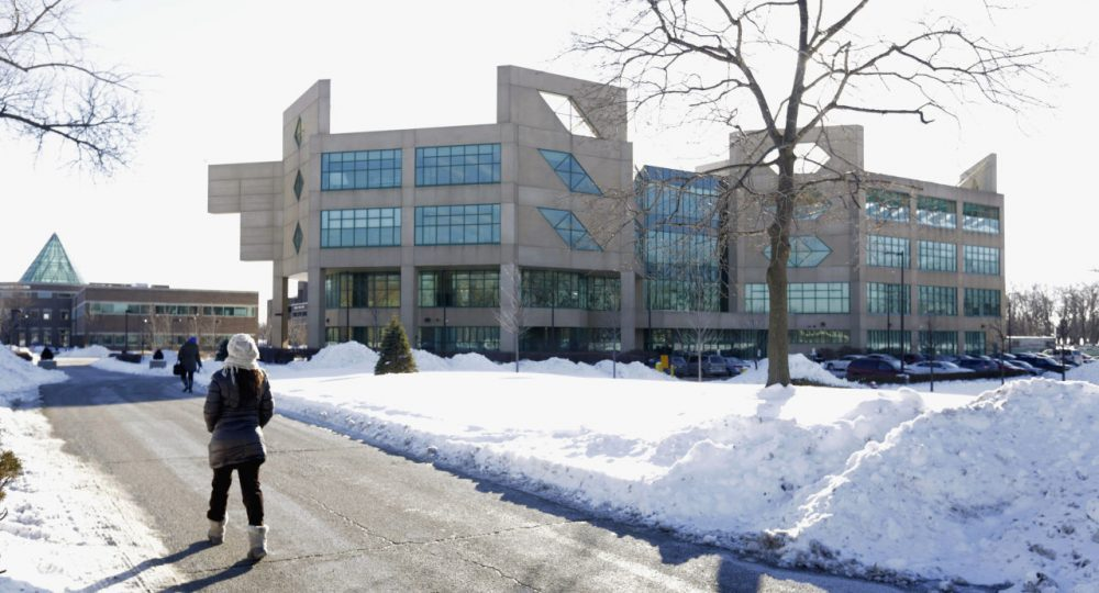 This Feb. 7, 2014 photo shows a student walking on the campus of Chicago State University in Chicago. The university will skip spring break this year and finish the school year early to save money as it continues to wait for state funding. University President Thomas J. Calhoun said in a memo Tuesday, Feb. 23, 2016 to faculty and students that spring break will be skipped and the spring semester will end early. Illinois' public universities and community colleges haven't received state money since summer because of the budget stalemate. (M. Spencer Green/AP)