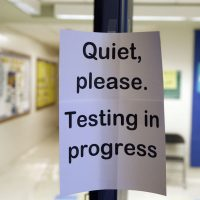 In this photo taken Jan. 17, 2016, a sign is seen at the entrance to a hall for a college test preparation class at Holton Arms School. (Alex Brandon/AP)