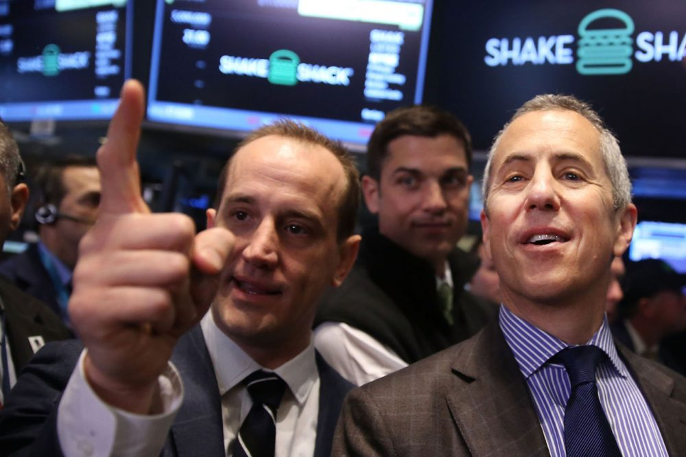 CEO of Shake Shack Randy Garutti (Left) and founder and Chairman Danny Meyer visit the floor of the New York Stock Exchange (NYSE) on January 30, 2015 in New York City. Hamburger chain Shake Shack rose more than 130 percent in its trading debut on the NYSE Friday. Shares for the New York based burger chain opened at $47 and quickly climbed above $52 before dipping back to $48.77 for a 132 percent advance.  (Spencer Platt/Getty Images)