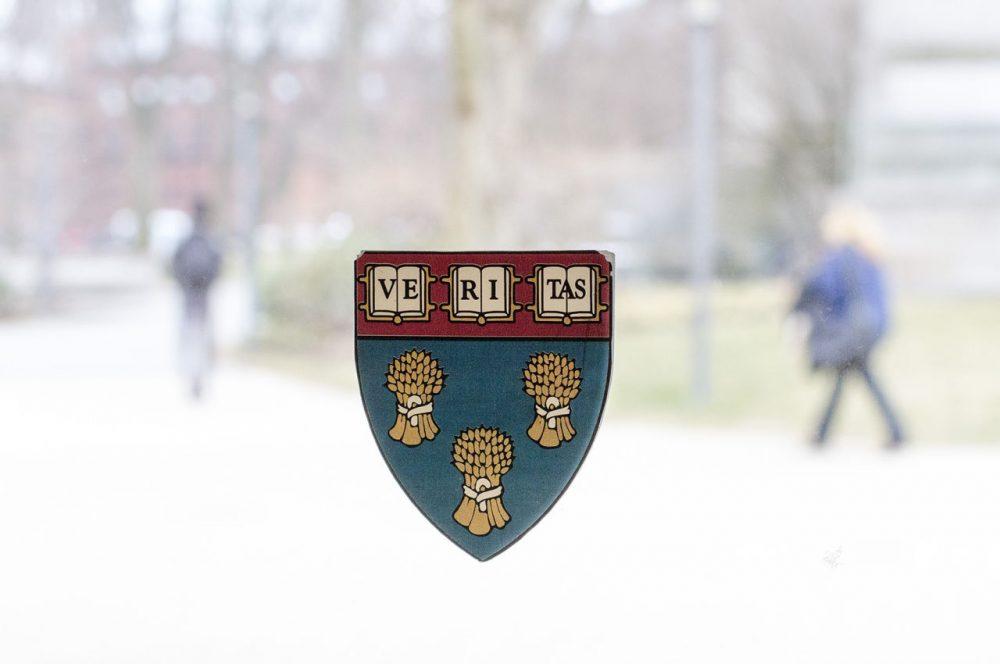 The Harvard Law School shield is seen on a window on campus. (Joe Difazio for WBUR)