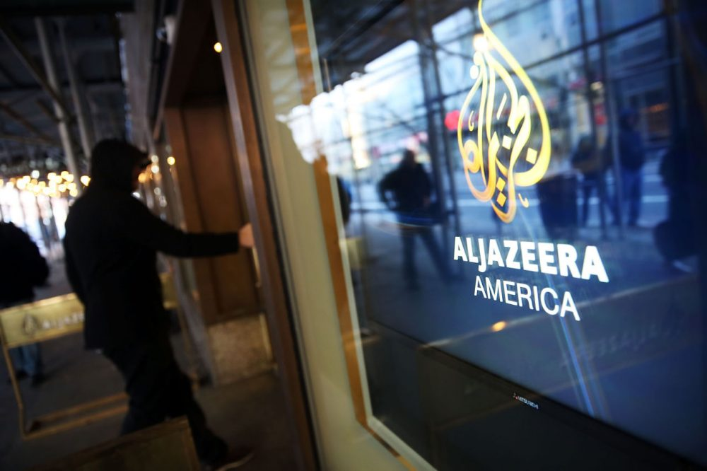 The logo for Al Jazeera America is displayed outside of the cable news channel's offices on January 13, 2016 in New York City. Al Jazeera America, which debuted in August 2013,  announced today that they are shutting down. Employees of the struggling news network known as AJAM were informed of the decision during an all-hands staff meeting on Wednesday afternoon.  (Spencer Platt/Getty Images)
