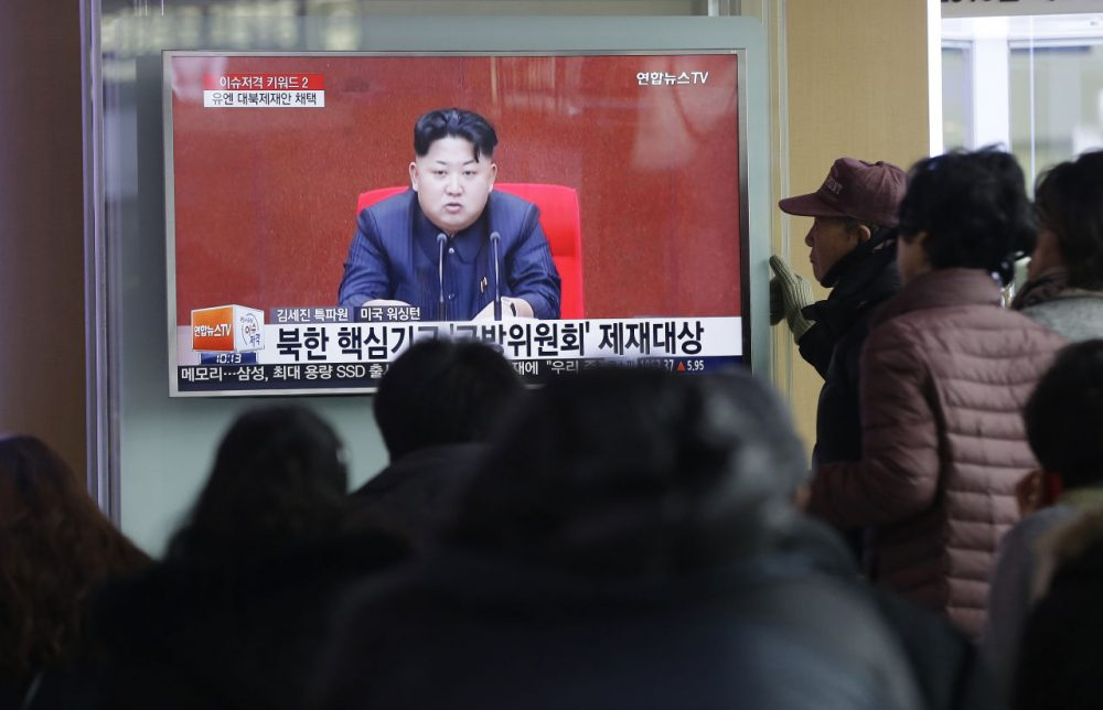 "People watch a TV news program showing North Korean leader Kim Jong Un, at Seoul Railway Station in Seoul, South Korea, Thursday, March 3, 2016. North Korea fired several short-range projectiles into the sea off its east coast Thursday, Seoul officials said, just hours after the U.N. Security Council approved the toughest sanctions on Pyongyang in two decades for its recent nuclear test and long-range rocket launch. The screen reads ""Sanction on the North Korea."" (Ahn Young-joon/AP)"
