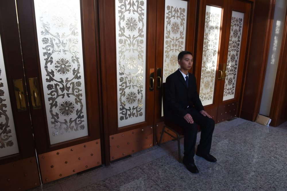 A security guard sits near a set of doors during delegation meetings at the National People's Congress in Beijing's Great Hall of the People on March 7, 2016. China's Communist-controlled parliament opened on March 5 to approve a new five-year plan to tackle slowing growth in the world's second-largest economy. (GREG BAKER/AFP/Getty Images)