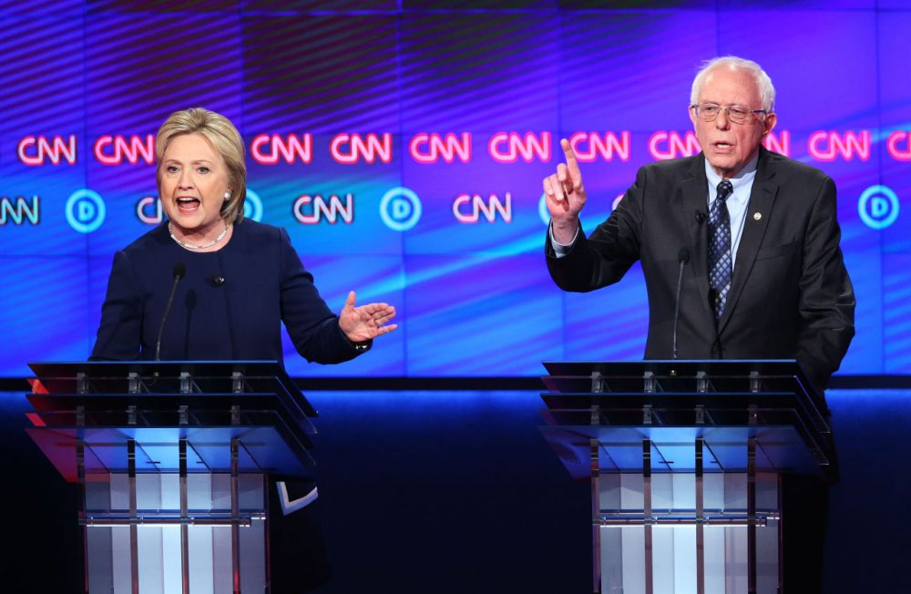 Democratic presidential candidate Senator Bernie Sanders (D-VT) and Democratic presidential candidate Hillary Clinton speak during the CNN Democratic Presidential Primary Debate at the Whiting Auditorium at the Cultural Center Campus on March 6, 2016 in Flint, Michigan. (Scott Olson/Getty Images)