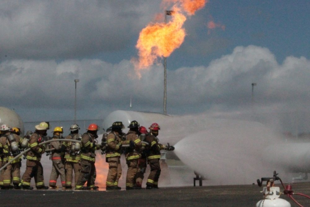 Volunteer firefighters training at Texas A&M's Disaster City in College Station. (Dave Fehling/Houston Public Media)