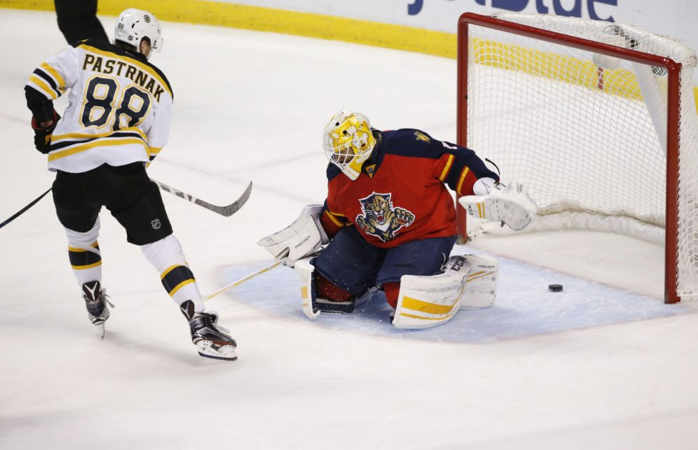 Boston Bruins right wing David Pastrnak scores against Florida Panthers goalie Roberto Luongo  during the first period. (Wilfredo Lee/AP)