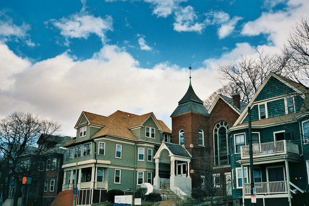 A cluster of homes and buildings in the city's Jamaica Plain neighborhood. The city's new pilot plan calls for the construction of more densely built homes that are affordable to middle-income families in Jamaica Plain, Roxbury and South Boston. (Soe Lin/Flickr)