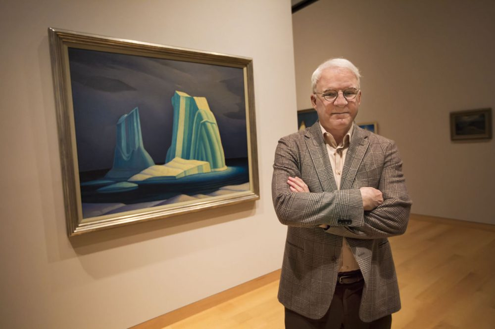 "Steve Martin in front of ""Icebergs"" on display at the Museum of Fine Arts Boston. (Jesse Costa/WBUR)"