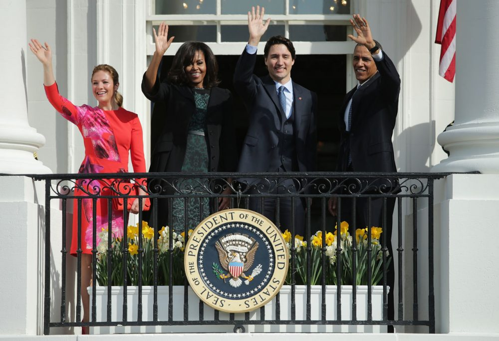 U.S. President Barack Obama (R) and Canadian Prime Minister Justin Trudeau (2nd R), U.S. first lady Michelle Obama (2nd L) and Sophie Grégoire-Trudeau (L) wave to invited guests from the Truman Balcony of the White House after an arrival ceremony at the White House, March 10, 2016 in Washington, DC. This is Trudeau's first trip to Washington since becoming Prime Minister. (Chip Somodevilla/Getty Images)