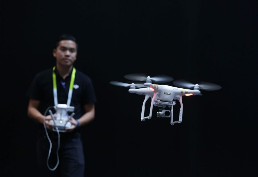 A DJI employee demonstrates flying a drone at CES 2016 at the Las Vegas Convention Center on January 7, 2016 in Las Vegas, Nevada. (Alex Wong/Getty Images)