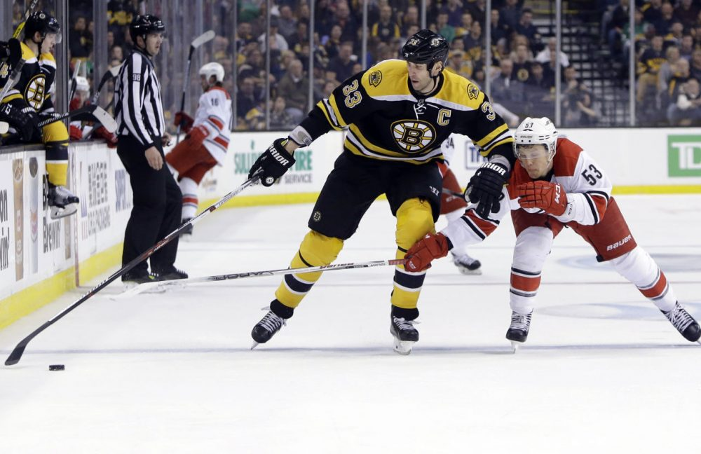 Bruins defenseman Zdeno Chara keeps the puck away from Hurricanes left wing Jeff Skinner a game at the Garden, Thursday, March 10, 2016, in Boston. (Elise Amendola/AP)