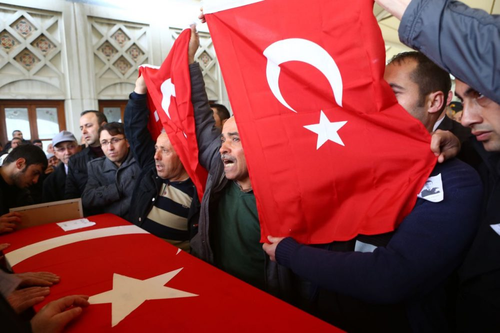 Men hold Turkish flags over the coffin of a victim in a mosque in Ankara, on March 14, 2016, a day after a suicide car bomb ripped through a busy square in central Ankara killing 37 people and wounding 125, officials said.  No one has claimed the attack, the latest in a spate of deadly attacks to hit Turkey. Turkish warplanes on March 14 struck the outlawed Kurdistan Workers' Party (PKK) in the mountainous Kandil and Gara regions in northern Iraq, the army said. (ADEM ALTAN/AFP/Getty Images)