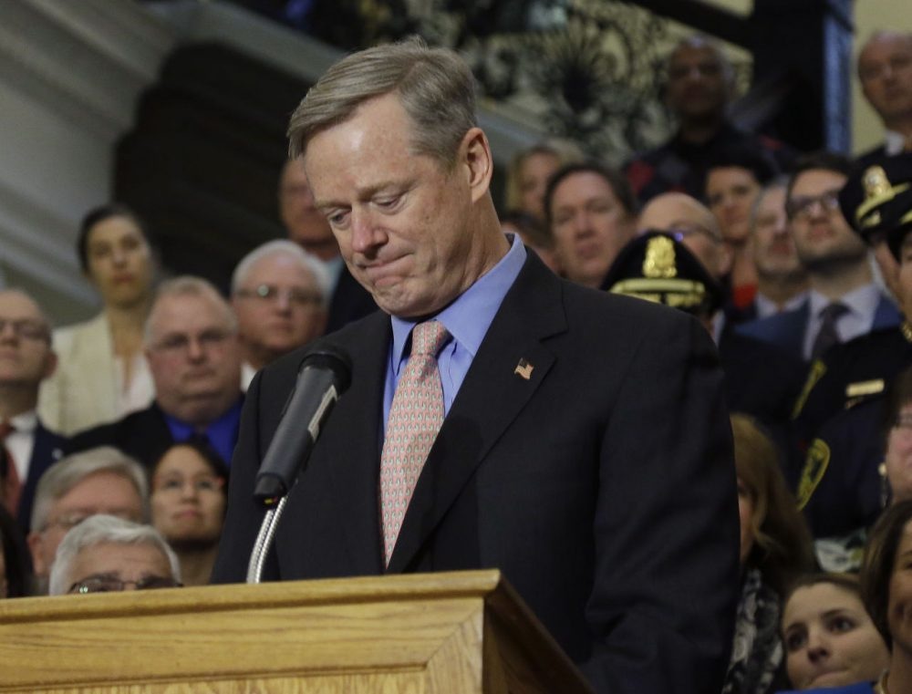 Mass. Gov. Charlie Baker becomes emotional as he speaks after signing sweeping legislation aimed at reversing a deadly opioid addiction crisis, during a signing ceremony at the Statehouse Monday. (Elise Amendola/AP)
