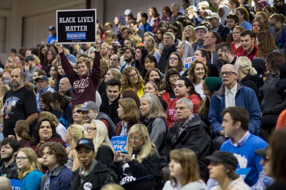 People wait for the arrival of Democratic presidential candidate Bernie Sanders at a campaign rally at Affton High School on March 13, 2016 in St Louis, Missouri. Sanders was campaigning ahead of the Missouri primary on March 15. (Whitney Curtis/Getty Images)