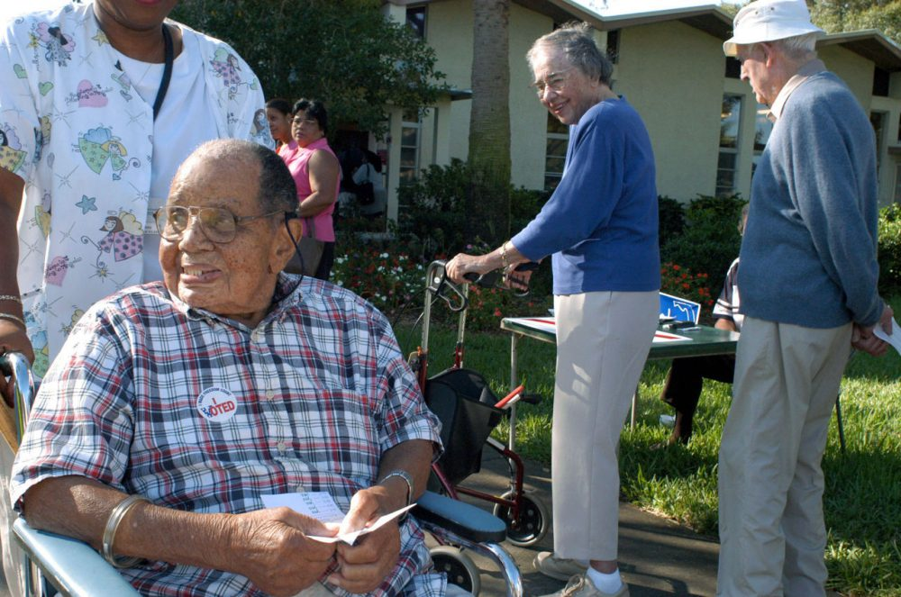 Silas Simmons, 109, leaves a polling place after casting his ballot November 2, 2004 in St. Petersburg, Florida. (Tim Boyles/Getty Images)