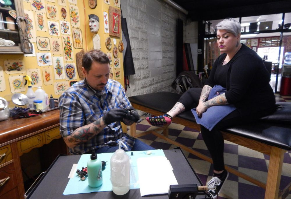 Tony Caporusso gave his wife Carrie Metz-Caporusso the first Flint tattoo of the day.(Mercedes Mejia)