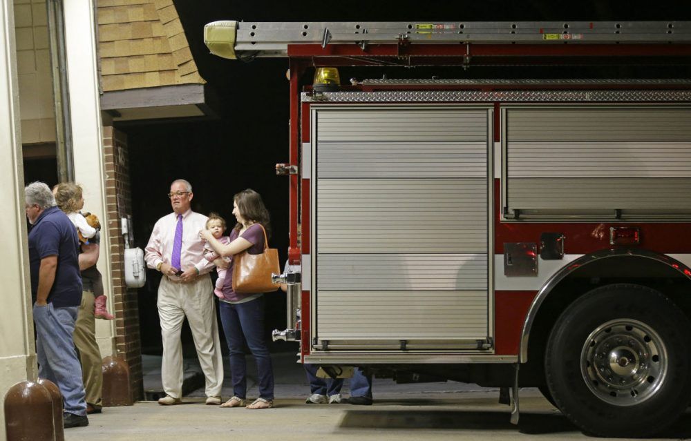 Voters line up to cast their ballots during the primary election at Cary Fire Station 9 in Cary, N.C., Tuesday, March 15, 2016. (AP Photo/Gerry Broome)