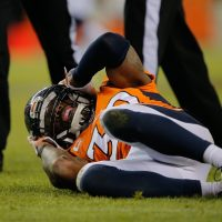 David Bruton of the Denver Broncos lies on the ground in pain after a play that would force him out of the game with a reported concussion during a game against the Oakland Raiders at Sports Authority Field at Mile High on December 28, 2014 in Denver, Colorado.   (Doug Pensinger/Getty Images)