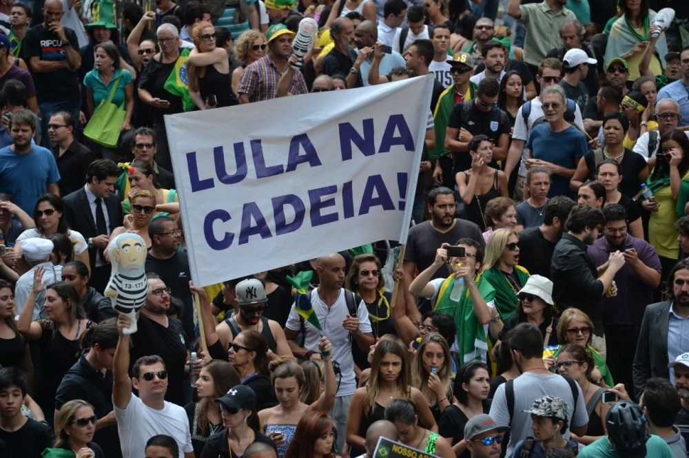 People demonstrate against Brazilian former president Luiz Inacio Lula da Silva in Sao Paulo downtown Brazil on March 17 2016. A federal judge in Brazil suspended President Dilma Rousseff's appointment of her predecessor Luiz Inacio Lula da Silva as her new chief of staff Thursday, amid allegations she gave him the post to protect him from corruption charges.  (Nelson Almeida/AFP/Getty Images)
