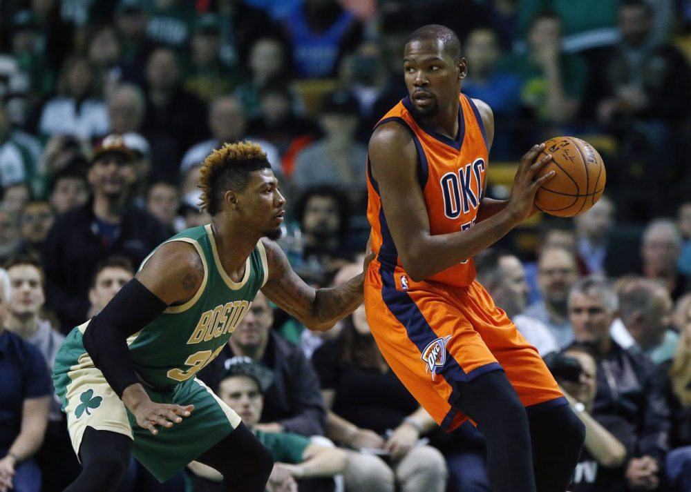 Thunder's Kevin Durant looks to move on Celtics' Marcus Smart during a game at the Garden, Wednesday, March 16, 2016. (Michael Dwyer/AP)