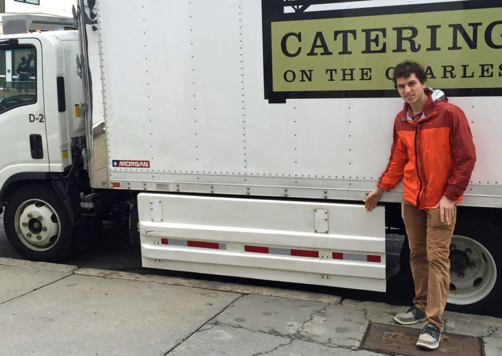 Dustin Weigl stands next to a Catering on the Charles truck that features side guards aimed at preventing cyclists or pedestrians from being pulled under the truck. Weigl is pushing to get the guards on all trucks. (Robin Young/Here & Now)