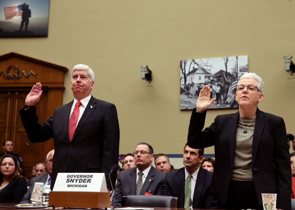 EPA Administrator Gina McCarthy, (R), and Gov. Rick Snyder, (R-MI), are sworn in during a House Oversight and Government Reform Committee hearing, about the Flint, Michigan water crisis, on Capitol Hill March 17, 2016 in Washington, DC. The committee is examining how lead ended up in the public drinking water in Flint, Michigan.  (Mark Wilson/Getty Images)