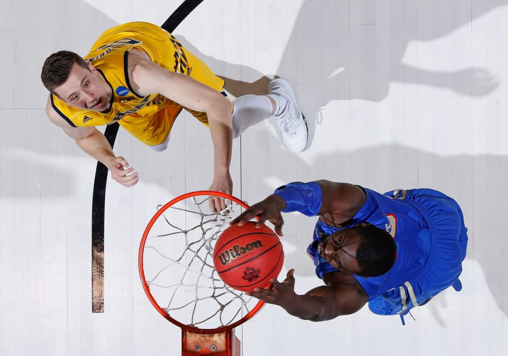 D'Andre Wright #40 of the Tulsa Golden Hurricane dunks against Sean Lonergan #20 of the Michigan Wolverines during the first round of the 2016 NCAA Men's Basketball Tournament at UD Arena on March 16, 2016 in Dayton, Ohio.  (Joe Robbins/Getty Images)