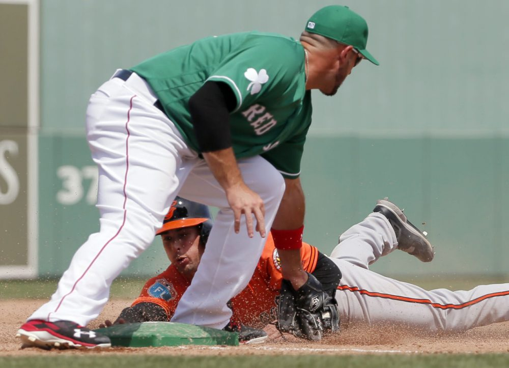 Orioles' Joey Rickard is tagged out trying to steal third by Red Sox' Travis Shaw in a spring training game, Thursday, March 17, 2016, in Fort Myers, Fla. (Tony Gutierrez/AP)