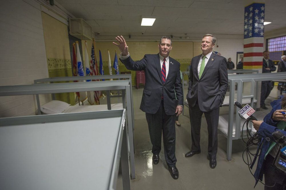 Middlesex Sheriff Peter Koutoujian shows Gov. Charlie Baker the bunks of the Housing Unit for Military Veterans at the Middlesex Jail & House of Correction in Billerica. (Jesse Costa/WBUR)