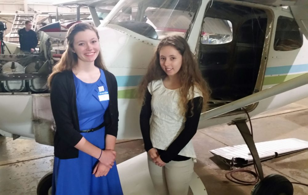 Emma Gay (left) and Anna Leya Fields are helping restore the 1950s Cessna 172 back to its former glory. (Jacob Ryan)