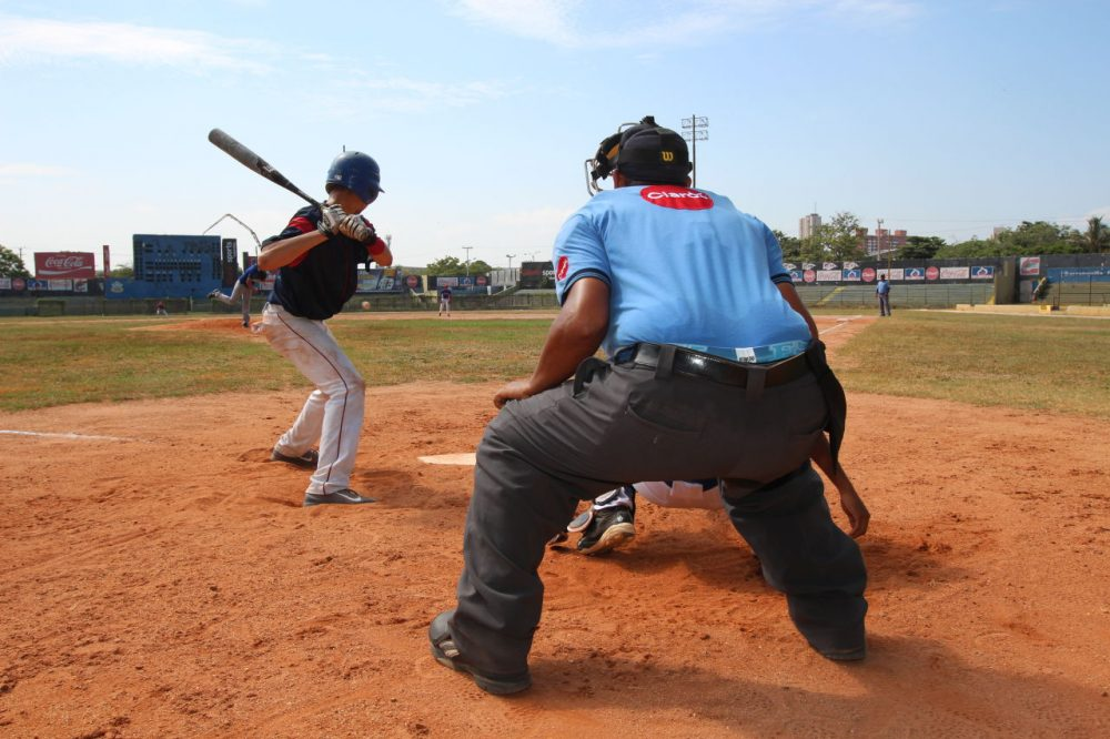 A prospects game at Estadio Tomás Arrieta, home of the Édgar Rentería Baseball Academy in Barranquilla on Colombia's Caribbean coast. Some players here said they dream of a pro career in the U.S. Others said they want to use their talent to get a U.S. college scholarship. (Lorne Matalon)