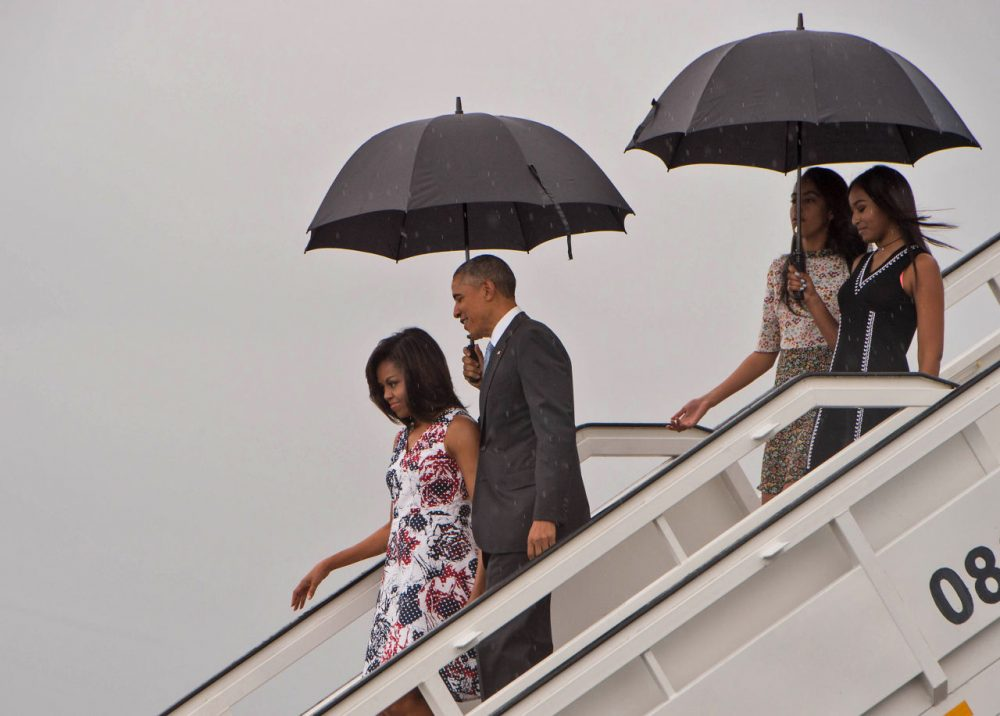 U.S. President Barack Obama, First Lady Michelle Obama and daughters Malia and Sasha disembark from Air Force One at the Jose Marti International Airport in Havana on March 20, 2016. Obama arrived in Cuba to bury the hatchet in a more than half-century-long Cold War conflict that turned the communist island and its giant neighbor into bitter enemies.     (Nicholas Kamm/AFP/Getty Images)