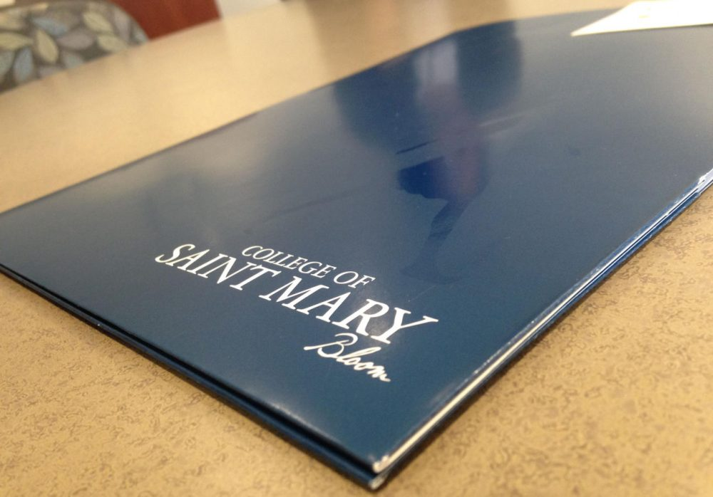 Four high school seniors in Kansas City, Missouri, recently applied for a near full-ride at the College of St. Mary in Omaha, Nebraska. (Kyle Palmer/KCUR)