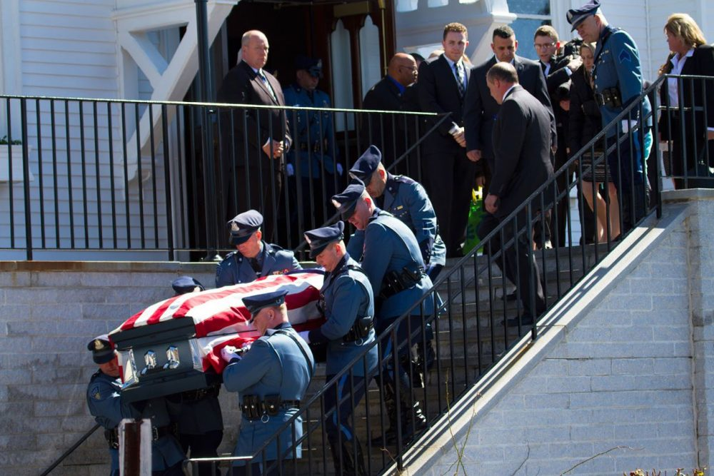 State troopers carry Trooper Thomas Clardy's casket down the steps of St. Michael's Church in Hudson on Tuesday. (Hadley Green for WBUR)