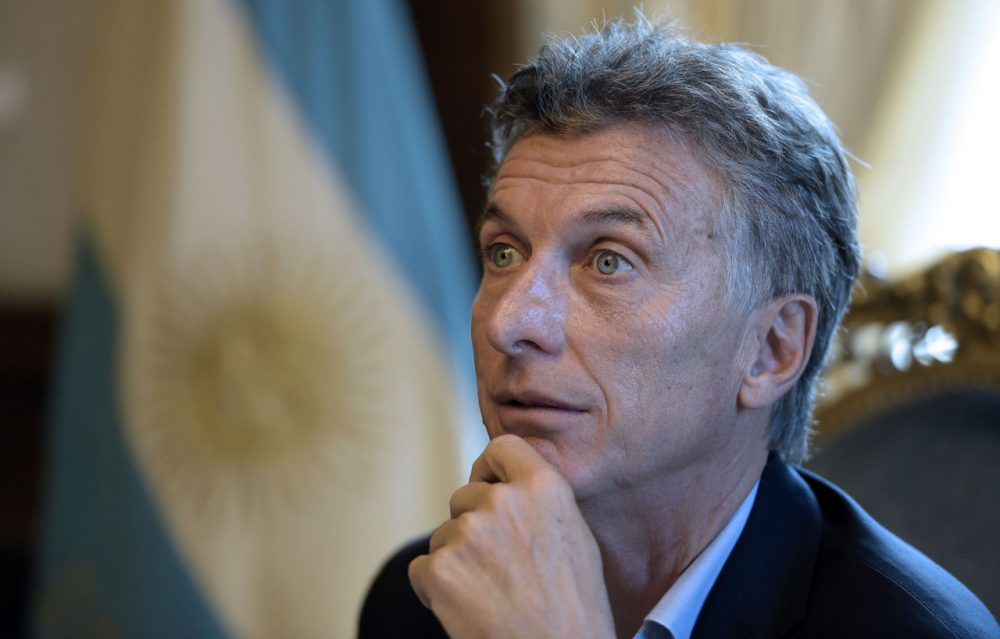 """Argentina's President Mauricio Macri offers an interview to AFP at the Casa Rosada presidential palace in Buenos Aires on February 22, 2016. Macri won elections in November 2015, ending 12 years of leftist and crisis-ridden rule by the late Nestor Kirchner and his wife Cristina. US President Barack Obama will travel to Argentina next month, offering support to Macri's efforts to end a decade-and-a-half of financial isolation and political enmity with Washington. Macri """"signaled that he'd like to have closer economic and diplomatic cooperation with the United States,"""" said top Obama foreign policy aide Ben Rhodes, announcing Obama's visit.  AFP / JUAN MABROMATA        (Juan Mabromata/AFP/Getty Images)"""